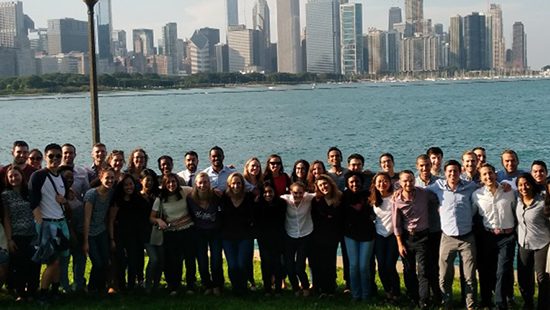 The current residents standing in front of the Chicago skyline